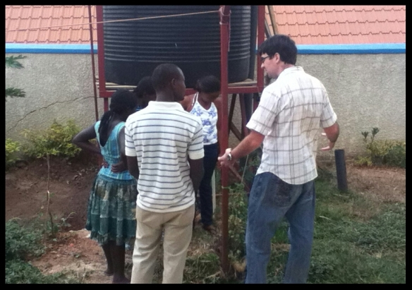 They got into a discussion about compost, so Mike explained how to start a compost heap.  (And helped Teresa start one.)