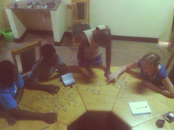 DTS staff use scrabble tiles to evaluate how the school is going